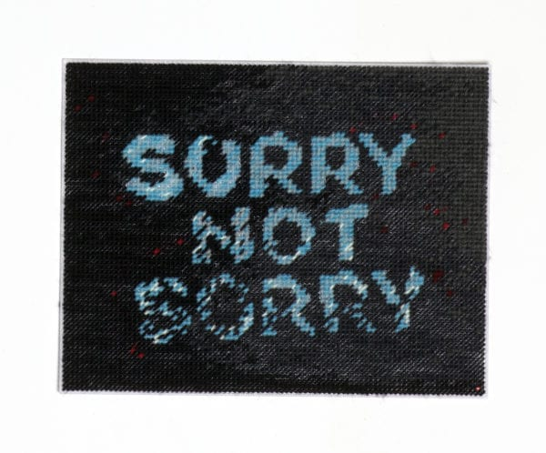 Not Sorry (2020) Hand Stitching, Mixed Yarn On Perforated Plastic, 26.5x33cm